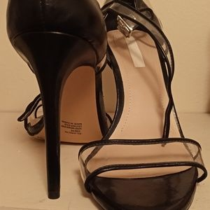 BCBG Clear and Black Strappy Pumps